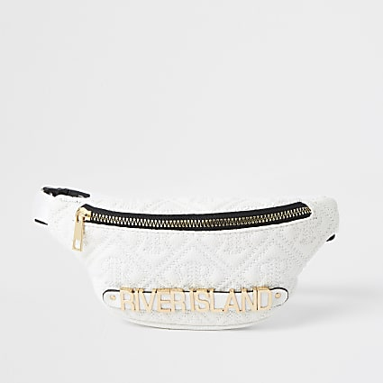 Girls cream quilted embossed monogram bumbag
