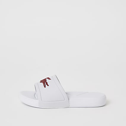 Girls Lacoste white logo sliders