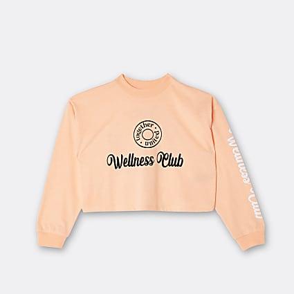 Girls orange graphic long sleeve top