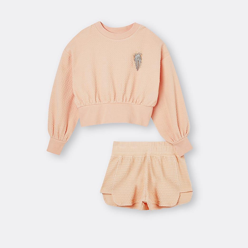 Girls orange sweatshirt and shorts outfit