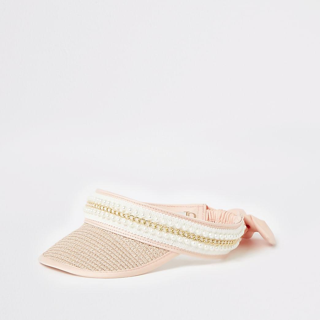 Roze verfraaide zonneklep met strooien rand