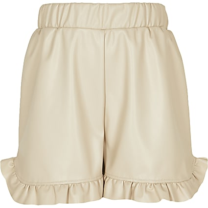 Girls pink faux leather ruffle hem shorts