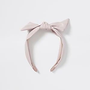 Roze haarband van imitatieleer met gedraaide knoop voor meisjes