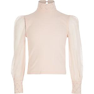 Roze top met siersteentjes enmesh mouwen voor meisjes