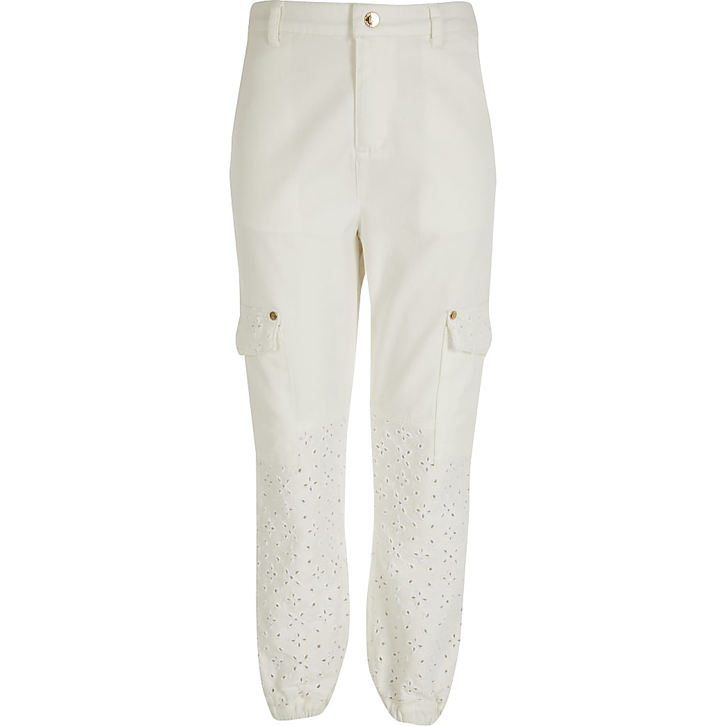 Girls white broderie denim trousers