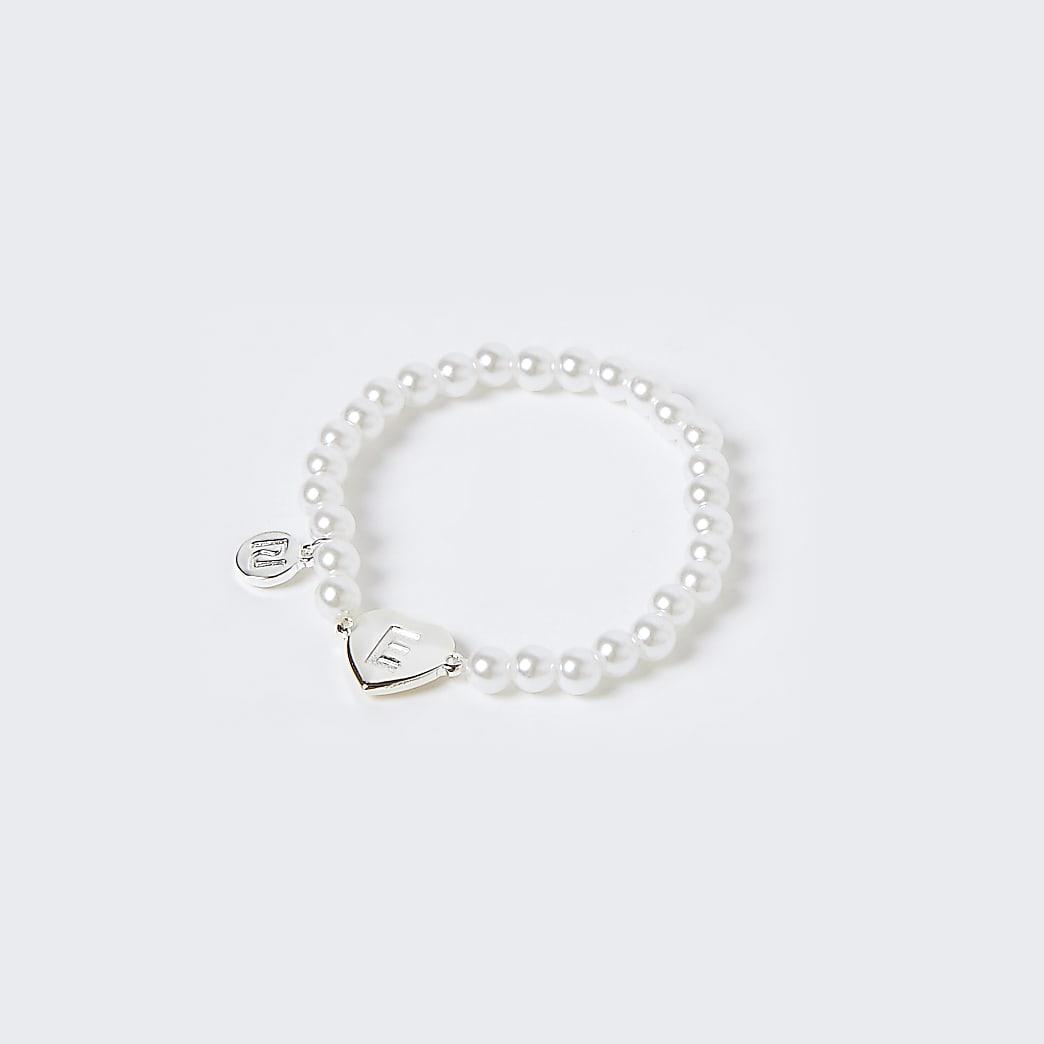 Girls white E initial bracelet