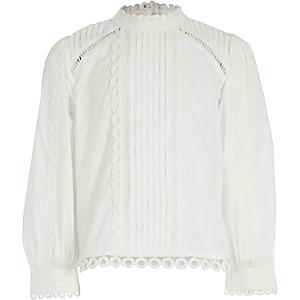 Witte geborduurde blouse met lange mouwen