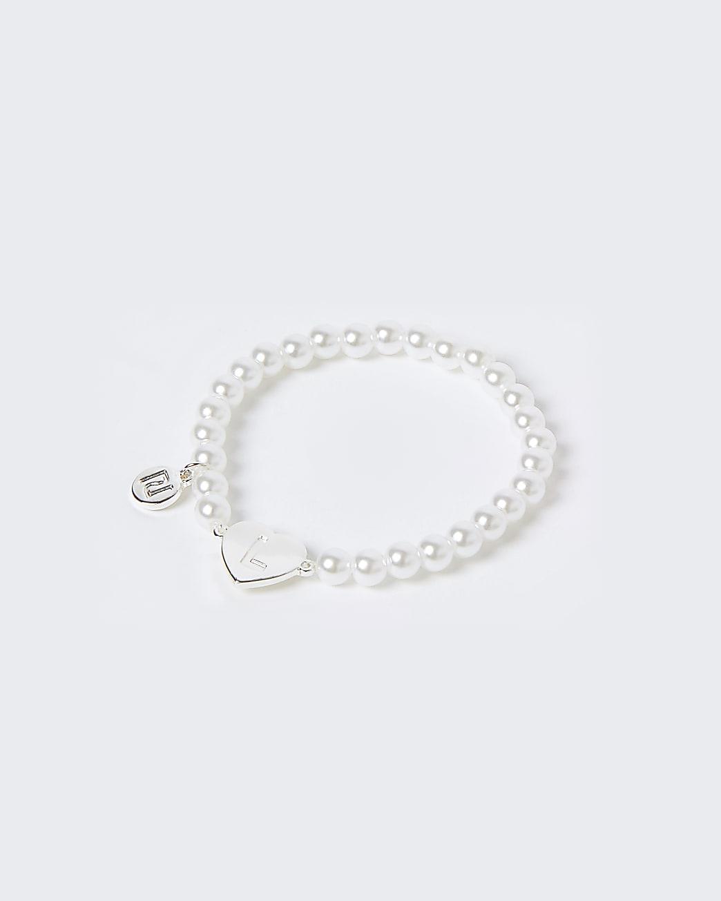 Girls white L initial bracelet