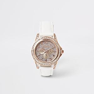 Weiße Armbanduhr mit Strassverzierung