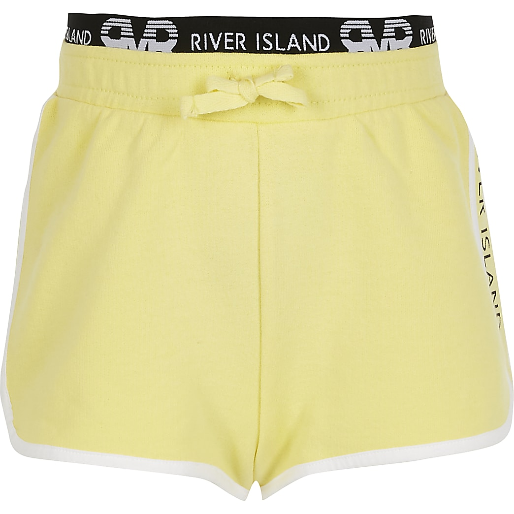 Girls yellow RI runner shorts