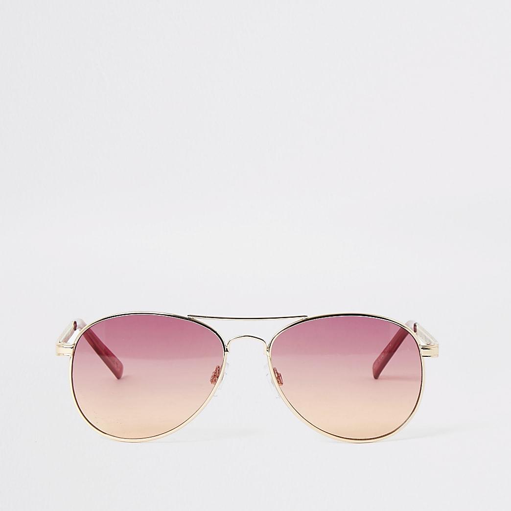Pilotenzonnebril met roze glazen en goudkleurige pootjes en montuur