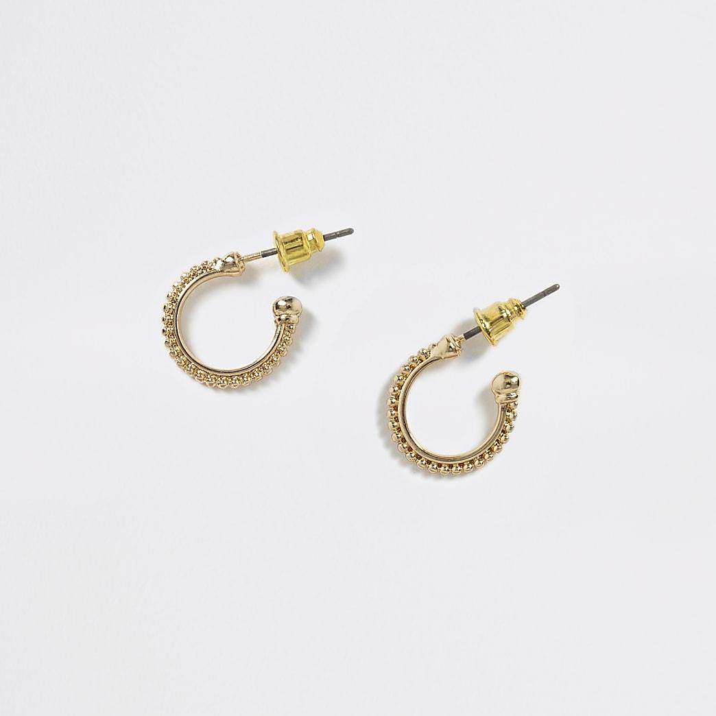 Goudkleurige ronde oorbellen met kraaltjes