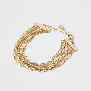 Goldfarbenes Armkettchen im Lagen-Look und mit Perlen