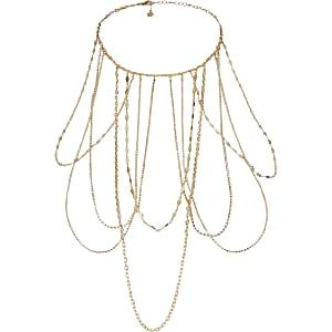 Goudkleurige geschakelde ketting met gedrapeerde kettinkjes met siersteentjes