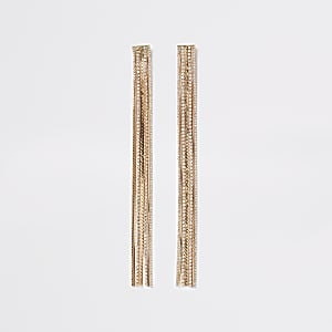 Goldene Ohrringe mit Kettenquasten und Strass