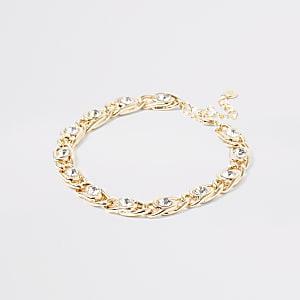 Goudkleurige stevige enkelband met siersteentjes