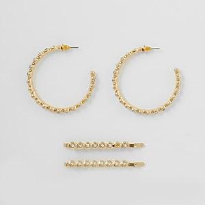 Set met goudkleurige ronde oorbellen en haarspeldjes met siersteentjes