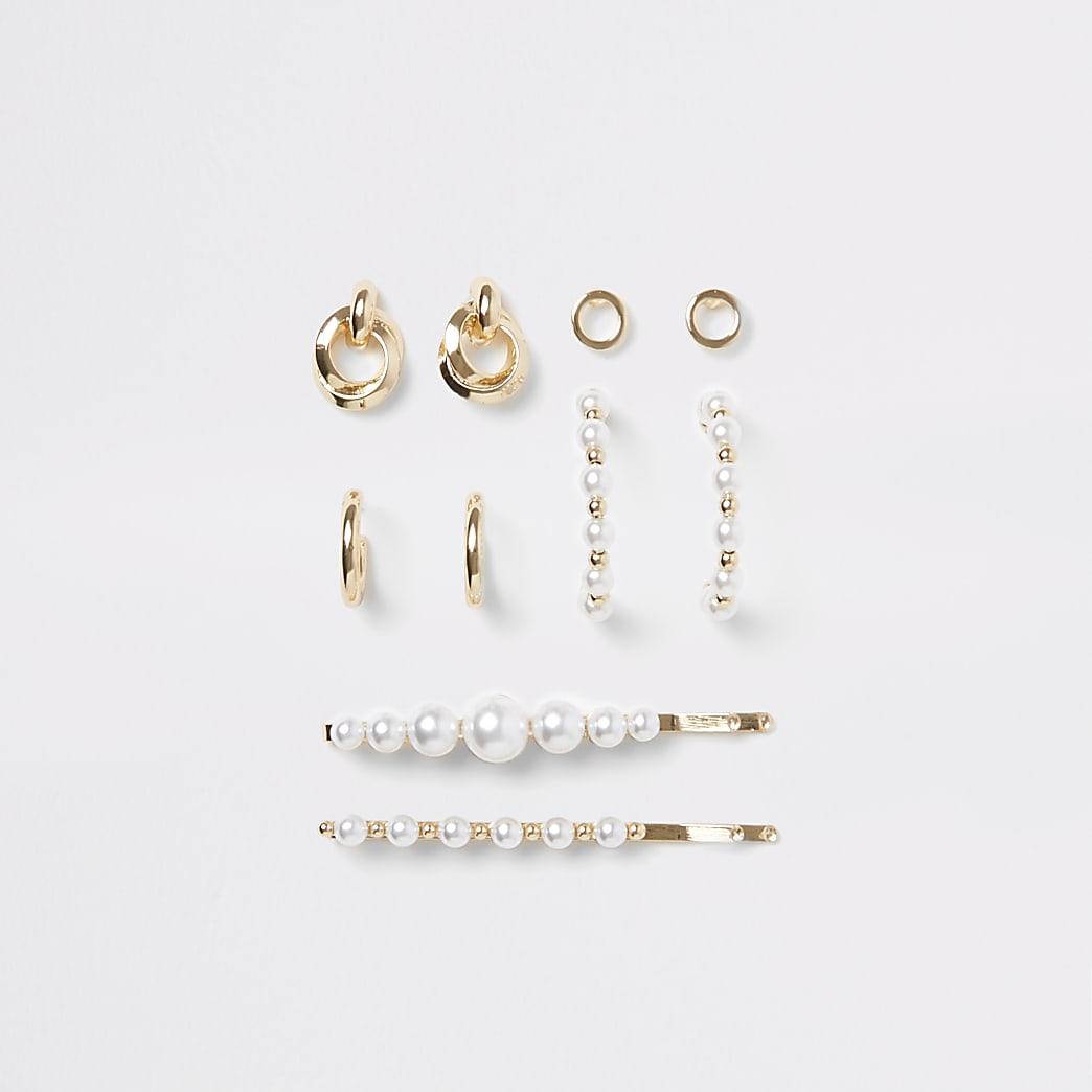 Set aus goldenfarbenen Ohrringen und Haarspangen