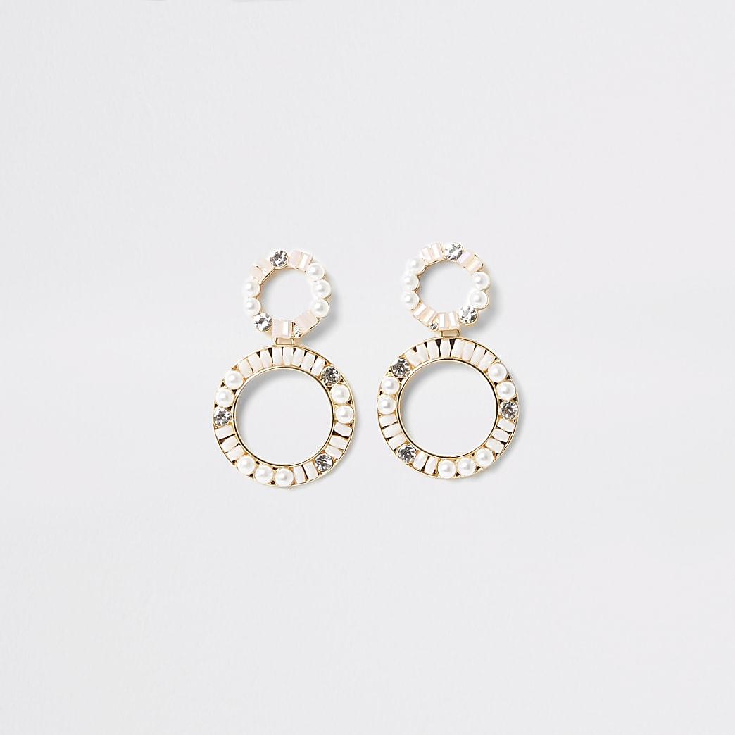 Pendants d'oreilles motif cercle dorés ornés