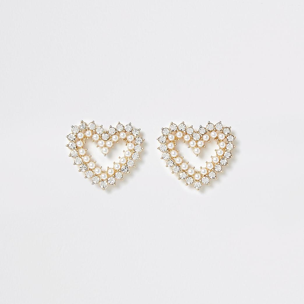 Boucles d'oreilles cœur dorées ornées de perles et de strass