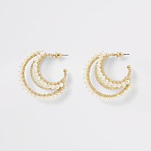 Goudkleurige gelaagde ronde oorbellen met parels