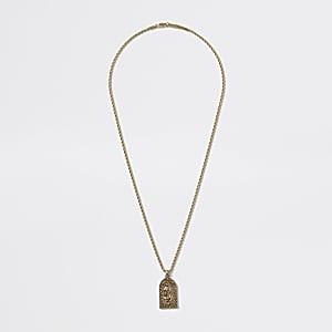 Collier doré avec pendentif religieux