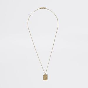 Goldfarbene Halskette mit strukturiertem Anhänger