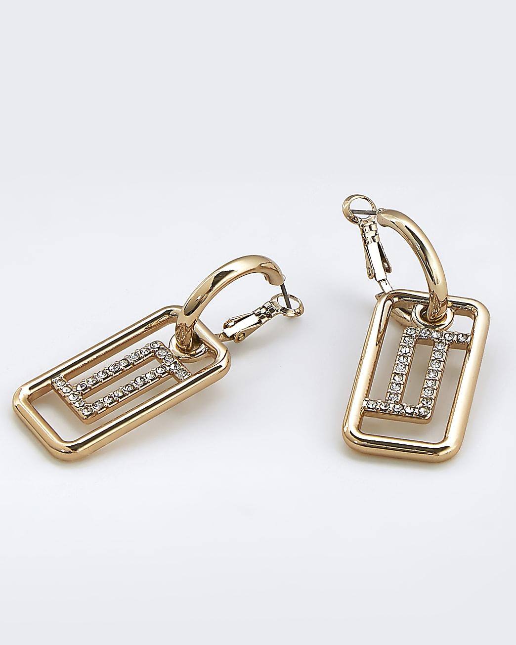 Gold cut out drop hoop earrings