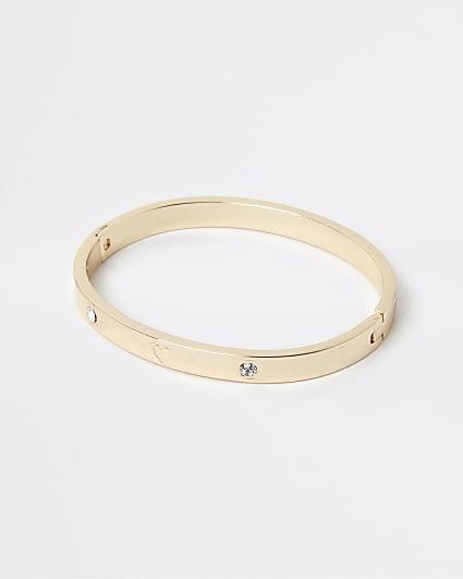 Gold diamante engraved heart bangle