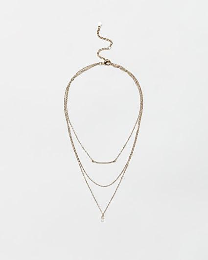 Gold diamante letter 'E' multirow necklace