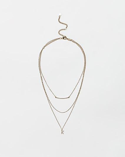 Gold diamante letter 'K' multirow necklace