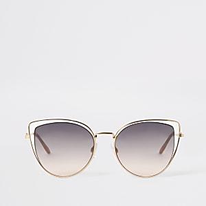 Goudkleurige zonnebril met dubbel kattenoogmontuur