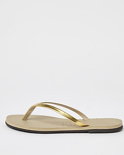 Gold Havaianas metallic flip flops