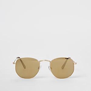 Goudkleurige zonnebril met zeshoekige vorm