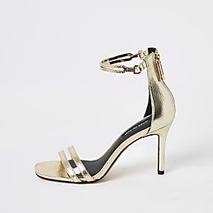 Goudkleurige sandalen met hoge hakken en enkelbandje
