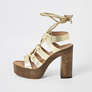 Goldene Plateau-Sandalen aus Leder mit Schnürung