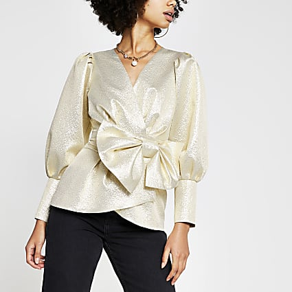 Gold long sleeve bow peplum top