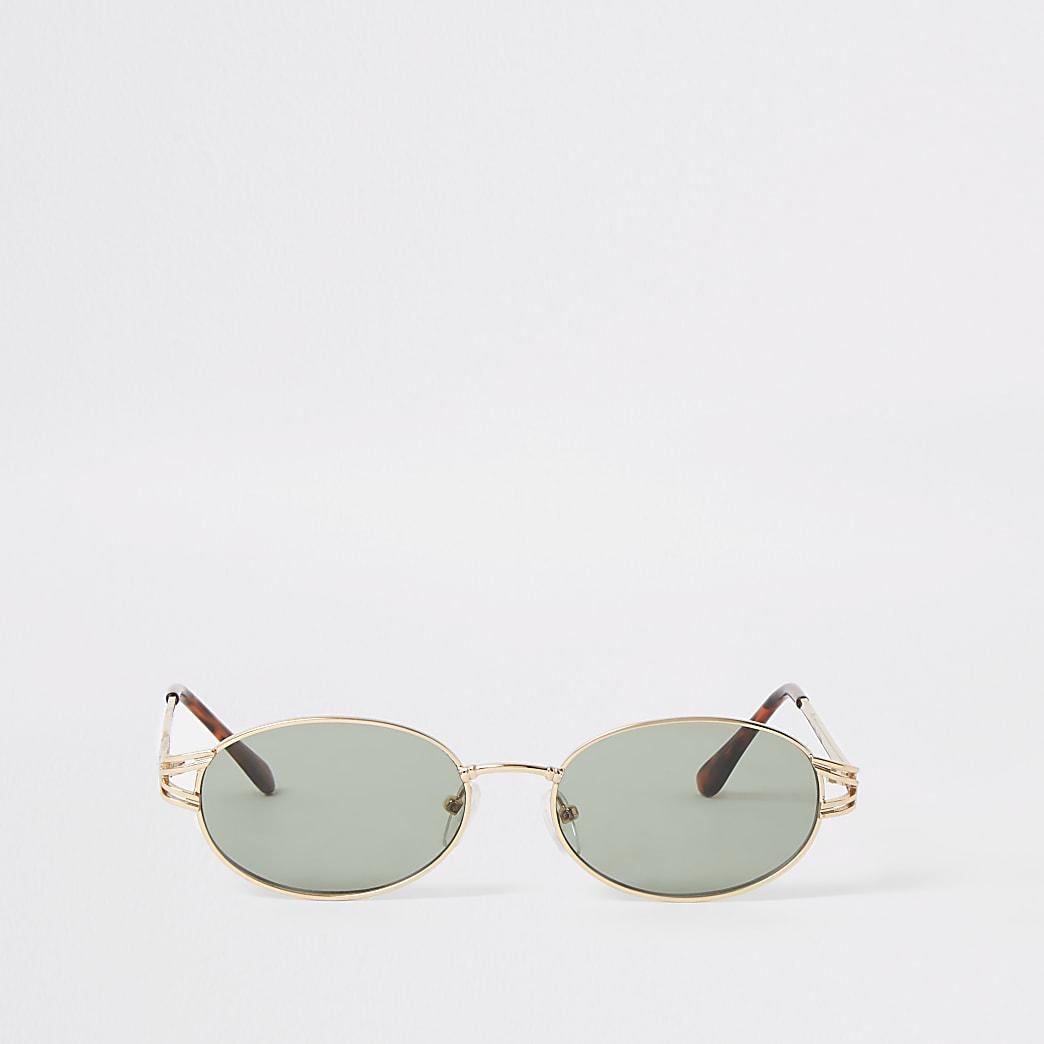 Goudkleurige zonnebril met ovale groene lens