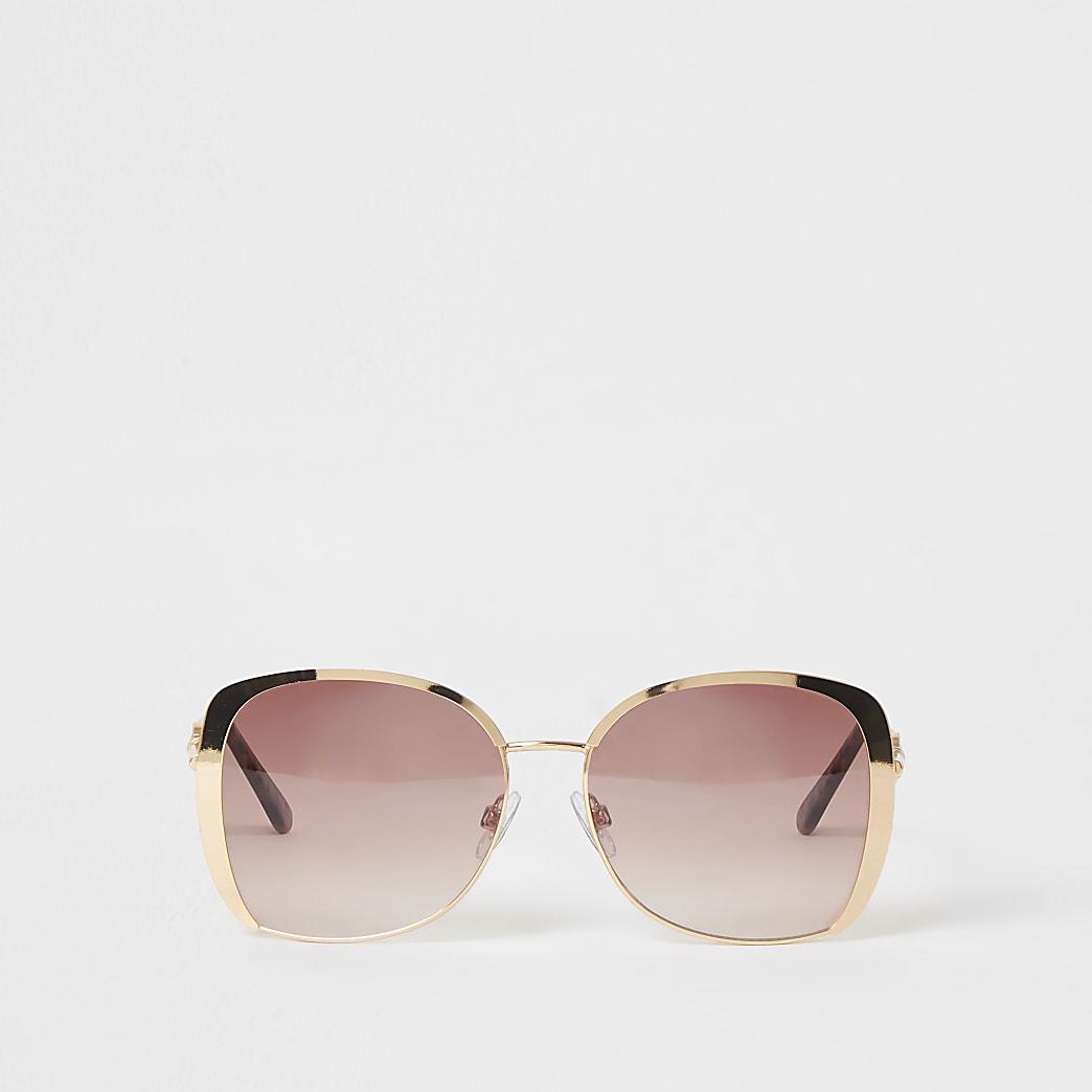 Lunettes de soleil surdimensionnéesdorées avec verre rose