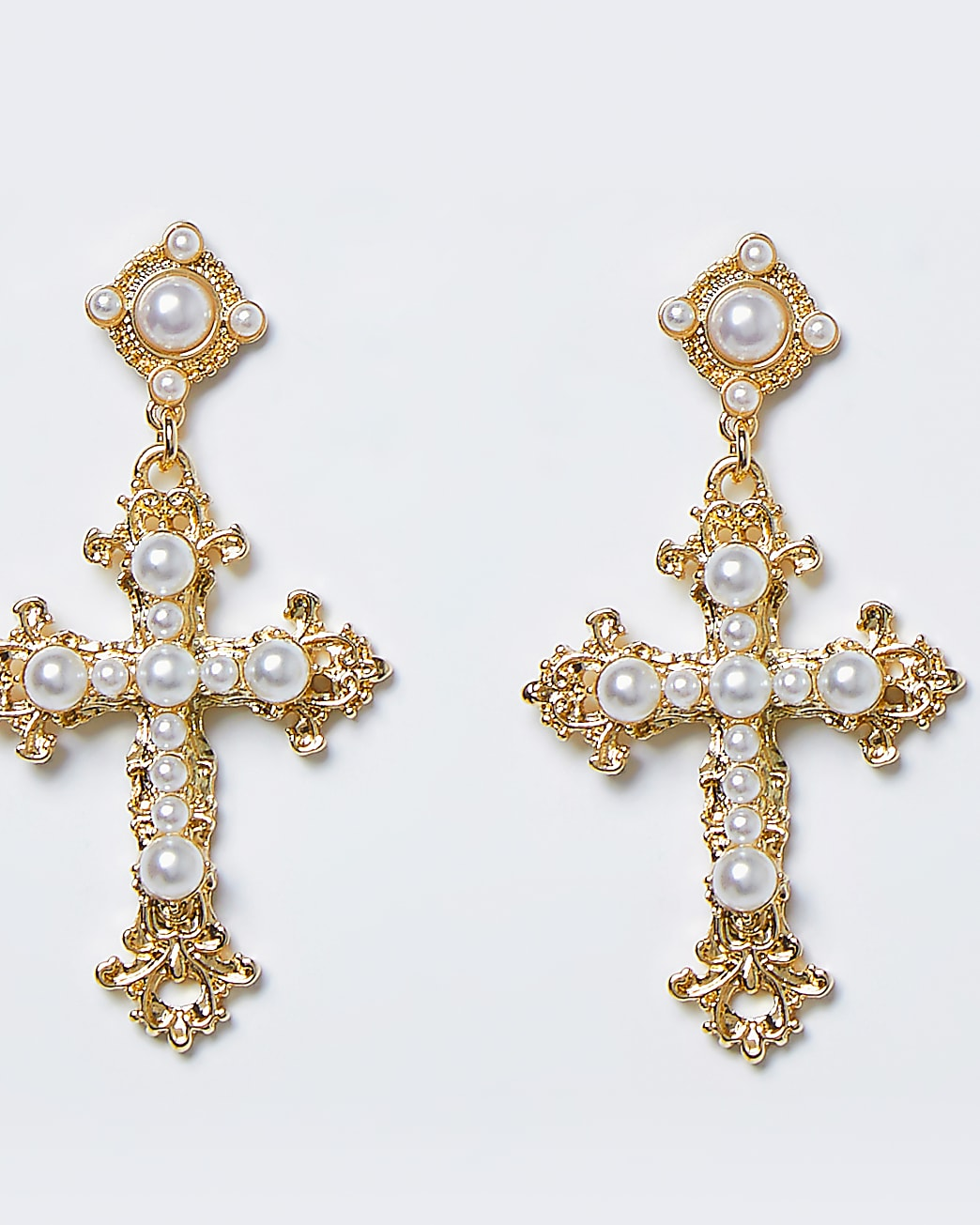 Gold pearl embellished cross drop earrings