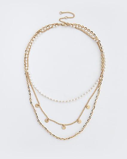Gold pearl embellished multirow choker