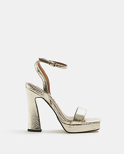 Gold platform heels