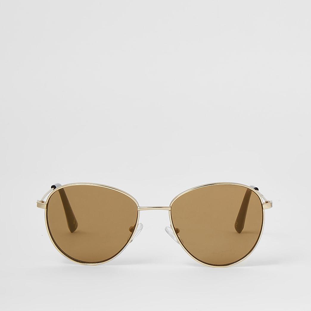 Goudkleurige zonnebril met rond montuur