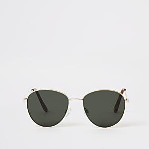 Goldene, runde Sonnenbrille mit grün getönten Gläsern