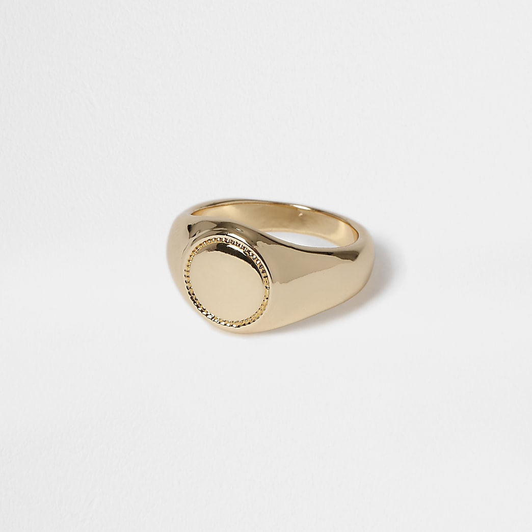 Gold round stone signet ring