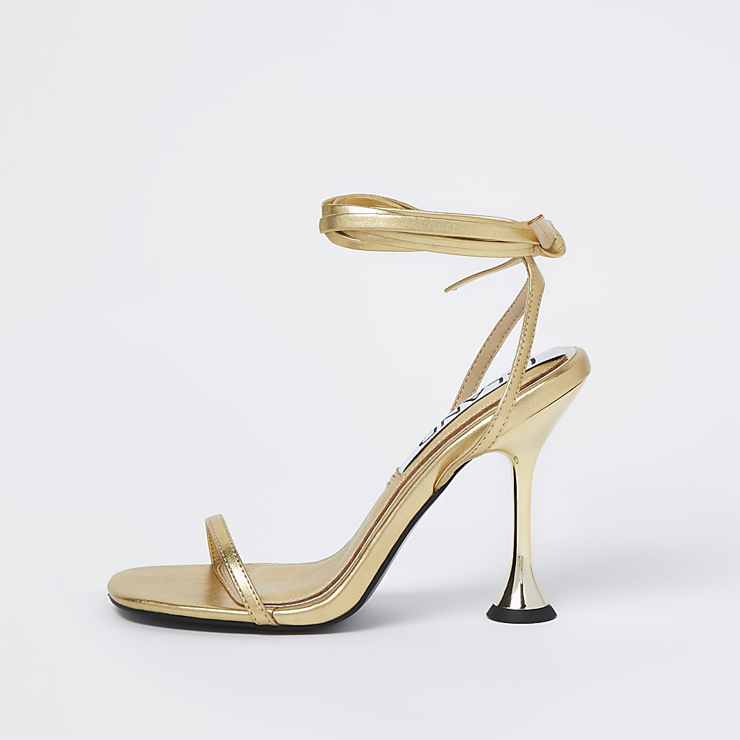 Gold strappy flared heel sandals