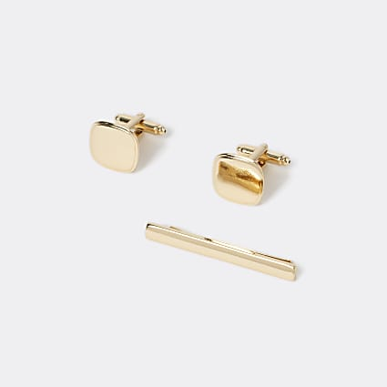 Gold tone cufflinks and tie pin set