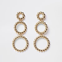 Gold tone triple twist hoop earrings