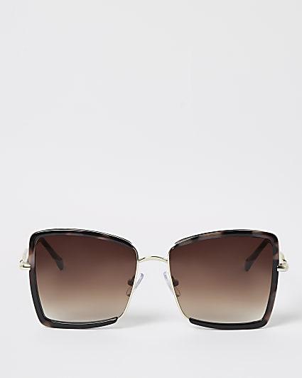 Gold tortoiseshell oversized sunglasses