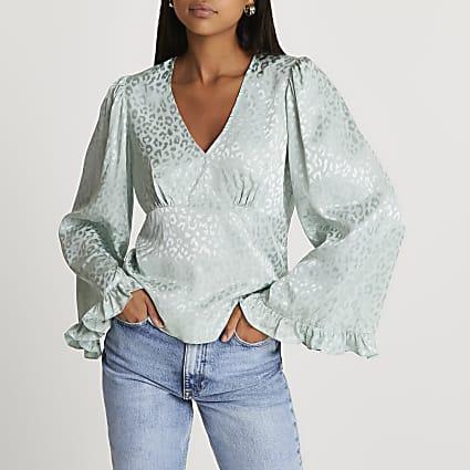 Green animal print flared sleeve blouse top